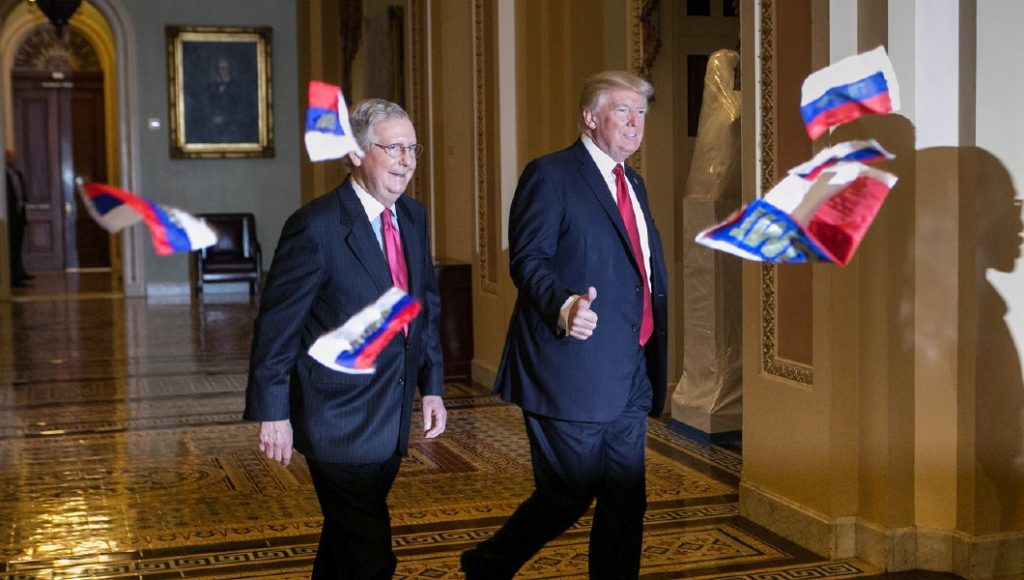 Protester throws Russian flags at President Donald Trump before Capitol Hill lunch